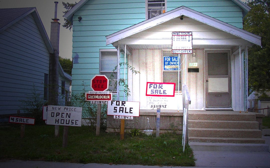For Sale by Owner Home with Many signs that look crazy
