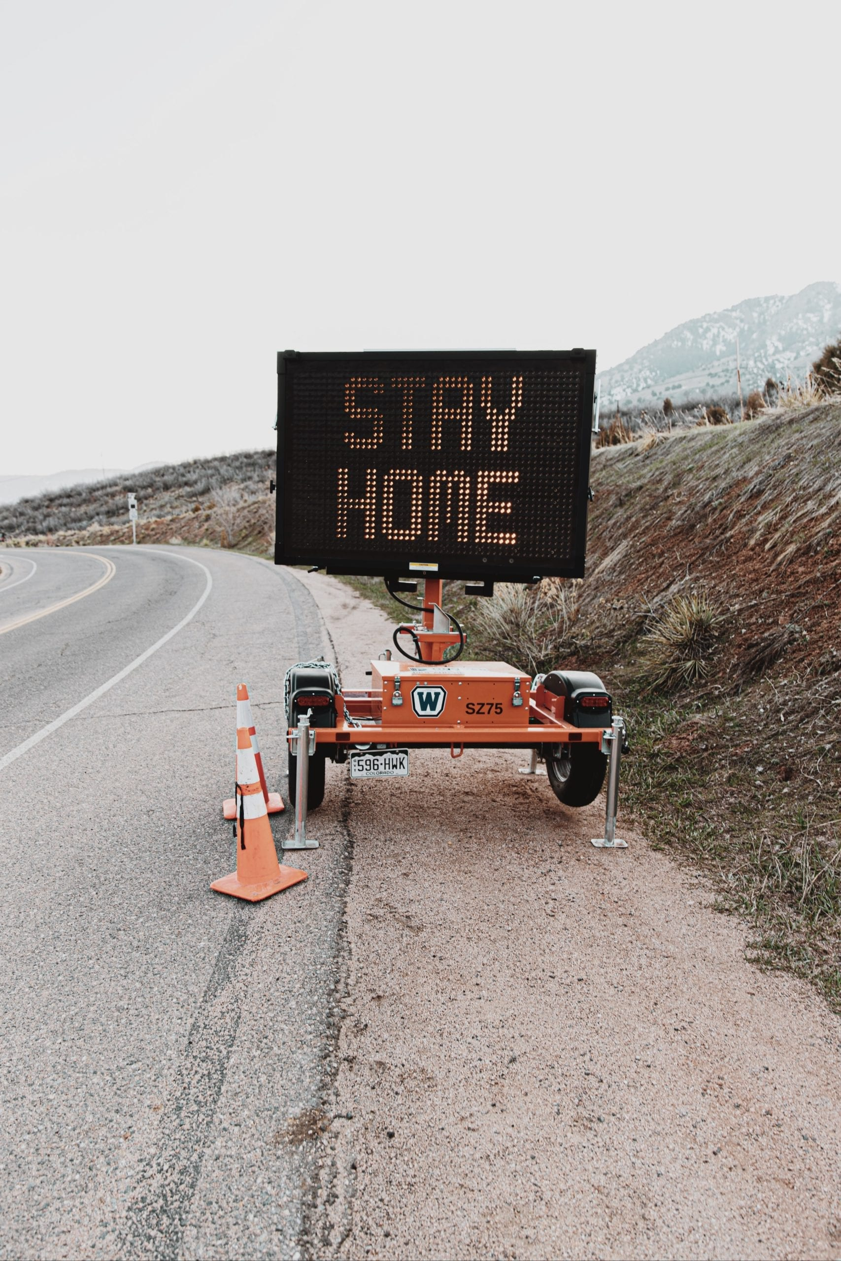 road sign stating stay home for coronavirus