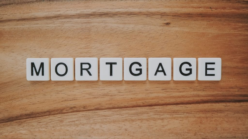 mortgage spelled with scrabble tiles on wood