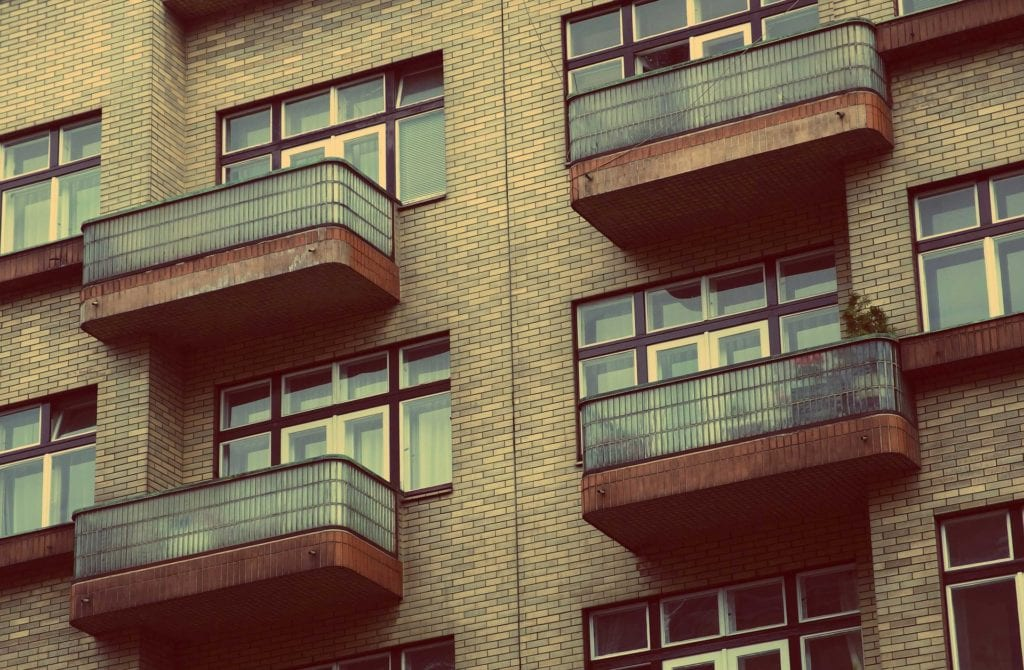 balconies on brown stone condominiums to articulate Homeowners Association Expenses