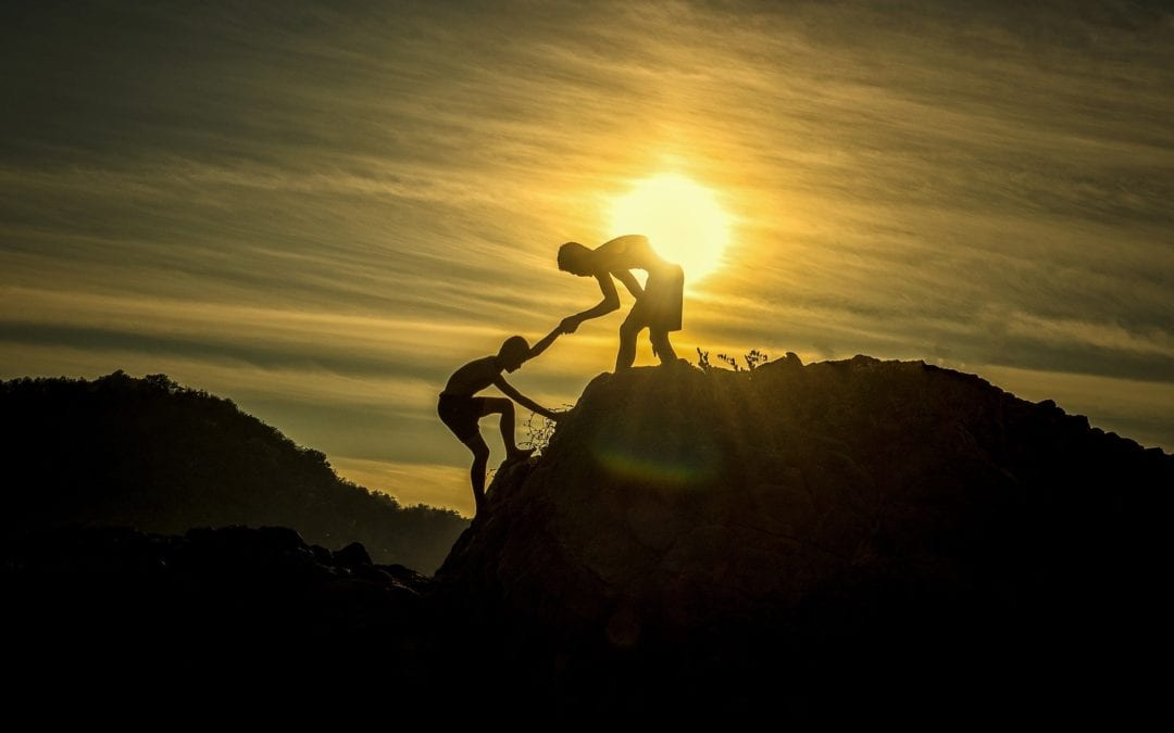 two people climbing a mountain hand in hand for short sale rescue illustration