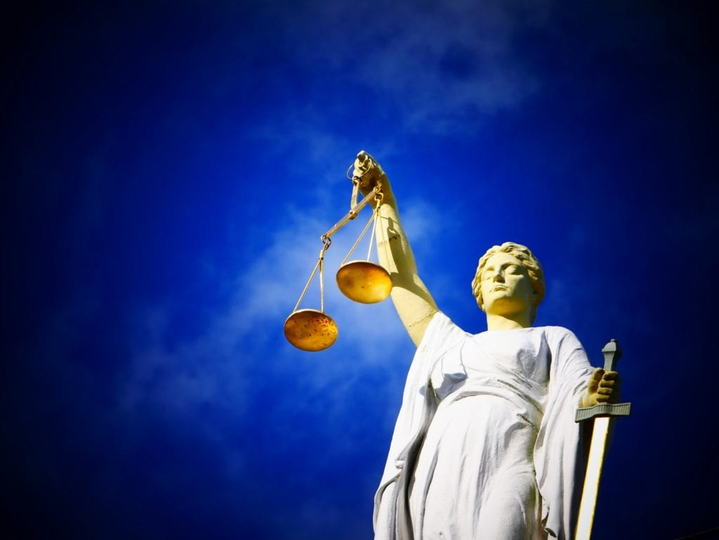 lady justice holding the scales for illustration of courtroom foreclosure attorney
