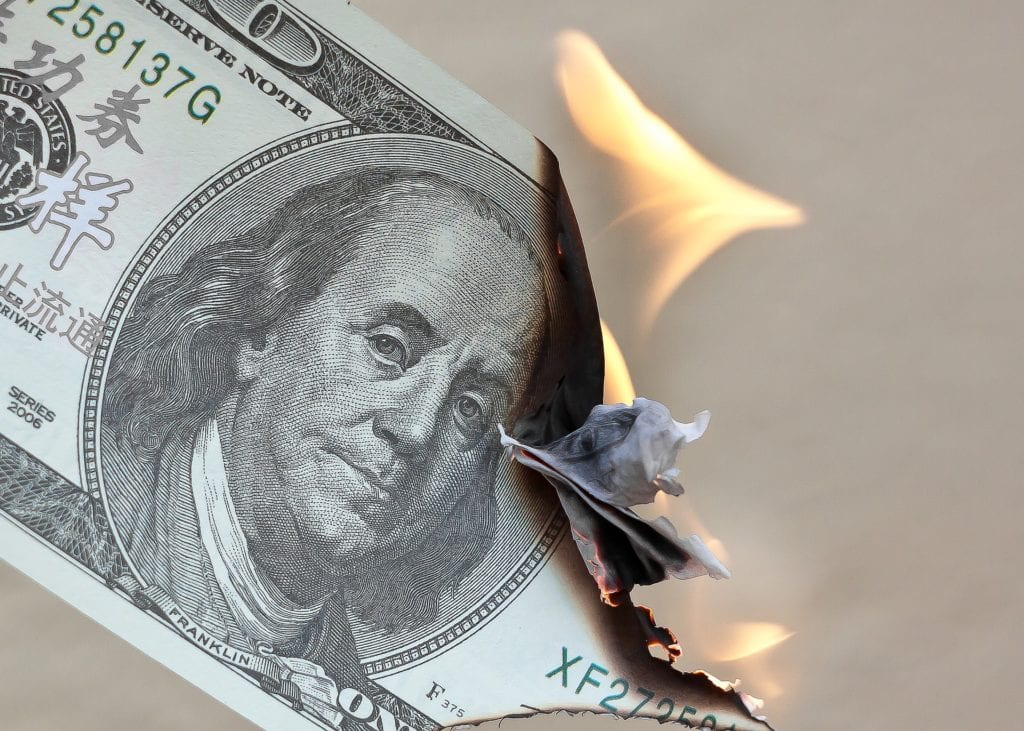 burning dollars as a show of debt and wasting money